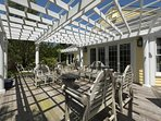 Broad, pergola-covered deck sets the stage for the special outdoor living space