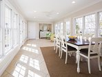 The sun filled porch offers casual dining
