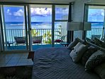 living room with lanai and beach/ocean views