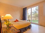 Bedroom with sliding door opening to terrace
