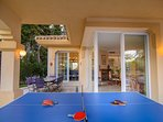 Terrace fitted with ping pong table next to pool