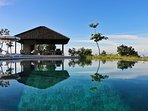 18m fresh water infinity pool perched on a hilltop w sweeping views over coral reefsand Lombok mtns.