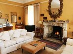 Enjoy the warmth of the fire in the elegant drawing room