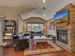 Tahoe Woods Penthouse - Living room with fireplace and TV