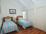 There is a guest room on the main floor with two twin beds and cathedral ceilings.