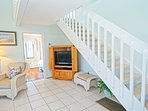 Head up stairs to the loft bedroom and sundeck.
