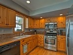 Stainless steel appliances complement the granite countertops.
