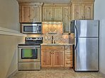 The lower-level features a well-equipped kitchenette.
