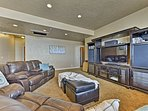 The basement family room is equipped with a flat-screen satellite TV.