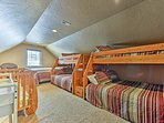 There's a queen bed, 2 twin-over-full bunk beds and 2 twin mattresses.