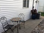 Enjoy a cup of coffee or a cold drink on the cozy back patio.