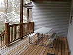 Back porch with table for outside dining.