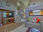 Both living spaces house 65-inch flat-screen cable TVs.