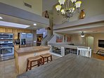 Vaulted ceilings guide you into the fully equipped kitchen.