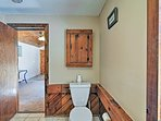 A shared bathroom sports wooden decor for a rustic log-cabin feel.