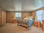 The master bedroom's plush queen-sized bed promises sweet dreams and deep sleep.