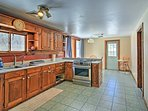 Ample counter space and an open kitchen make preparing meals easy.