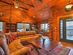 This wooded cabin features an open layout and cathedral ceilings.