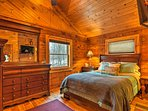 The master bedroom offers a cozy queen-sized bed.