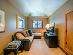 The loft has a full-size sleeper sofa for additional guests and a large TV.