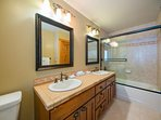 The upstairs guest bathroom features a combination shower/tub.