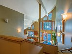 The lofted ceiling stretches high above the kitchen and dining areas.