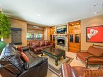 On the far end of the living area there's a fireplace below a mounted TV, and plenty of seating.