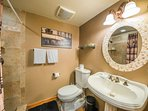 The first-floor guest bathroom has a single sink and vanity.