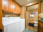 In the laundry room, you'll find a washer, dryer, and sink.