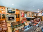 The living area also features a billiards nook with darts, air hockey, and a wet bar.