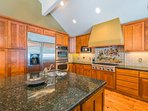 Enjoy a full kitchen with all stainless steel appliances, including a gas range and double oven.
