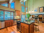 A wine fridge is tucked into the kitchen island, which is topped in granite.