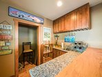 The game room features a wet bar with granite and stained-wood countertops.
