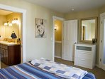 Master Bedroom With Plenty of Storage for Clothes and Items. Walk-In Closet With Ironing Board and Iron