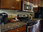 Kitchen Equipped with Keurig, Stainless Steel Appliances and Granite Countertops