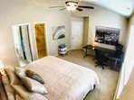Master Bedroom with Walk-In closet and Bathroom.  Table and monitor provided for any necessary work.
