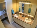 Master Bed and Bathroom with ample space to get ready or relax