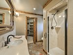 The en-suite bathroom provides a walk-in shower.