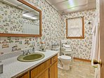 Get ready for the day in this first bathroom.