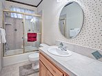 Wash your day away in this full bathroom.