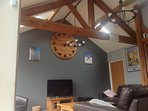 Large lounge with feature oak beams & clock