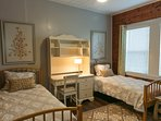 Comfy twin beds with awesome quilted comforters and plush pillows.
