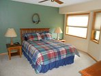 Master Suite which has TV, private bath & walk in closet.  Plus great view of Watersmeet Lake