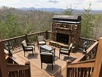 A Change In Altitude - downstairs outdoor party deck with gas fireplace