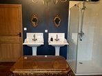 Bathroom 2 also features double sinks and a stand alone shower whilst completed with a chandelier