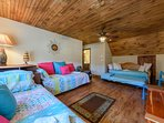 Upstairs Loft with Tongue in Groove Ceilings, 3 Twin beds and 1 Twin Trundle Bed