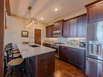 Kitchen with Quartz Counters and Stainless Appliances