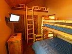 Stettin Haus TV in main floor bunk room with loft sleeping nook for 1