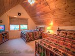Pinecone Manor Large Upstairs Bedroom with 2 Full Beds, Twin Sleeper Sofa, HDTV