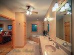 Pinecone Manor Main floor Master Bathroom w/ Whirlpool Tub and Enclosed Shower